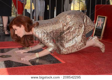 LOS ANGELES - OCT 6:  Debra Messing at the Debra Messing Star Ceremony at the Hollywood Walk of Fame on October 6, 2017 in Los Angeles, CA