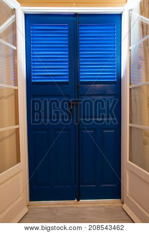 Blue door and window  with shutters