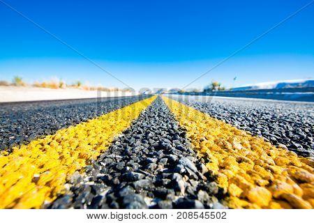 Yellow stripes on asphalt road