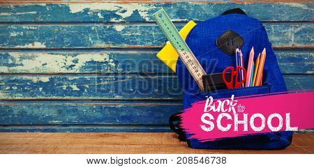 back to school against school bag on table