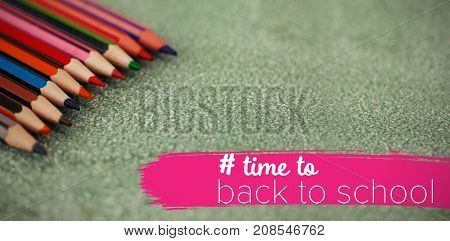 Back to school text with hashtag  against close-up of multi colored pencils arranged