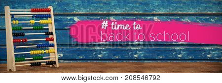 Back to school text with hashtag  against multi colored abacus on table