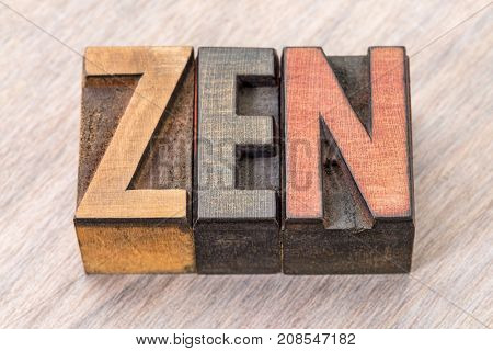 zen - word abstract in vintage wooden letterpress printing blocks stained by color inks