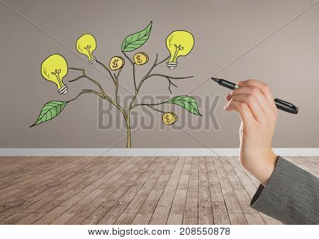 Digital composite of Hand holding pen and Drawing of Money and idea graphics on plant branches on wall