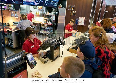 SAINT PETERSBURG, RUSSIA - CIRCA SEPTEMBER, 2017: people queue at a McDonalds's restaurant. McDonald's is an American hamburger and fast food restaurant chain.
