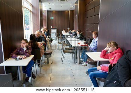 SAINT PETERSBURG, RUSSIA - CIRCA SEPTEMBER, 2017: people at McDonald's in Saint Petersburg. McDonald's is an American hamburger and fast food restaurant chain.