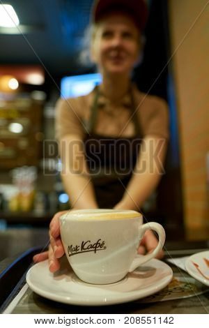 SAINT PETERSBURG, RUSSIA - CIRCA OCTOBER, 2017: close up shot of a cup with coffee at a McCafe. McCafe is a coffee-house-style food and beverage chain, owned by McDonald's.