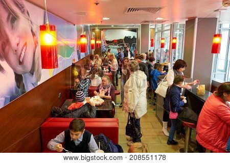 SAINT PETERSBURG, RUSSIA - CIRCA SEPTEMBER, 2017: people at McDonald's in Saint Petersburg. McDonald's is an American hamburger and fast food restaurant chain.