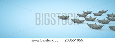 Digital composite of Group of dollar money Paper boats on blue background