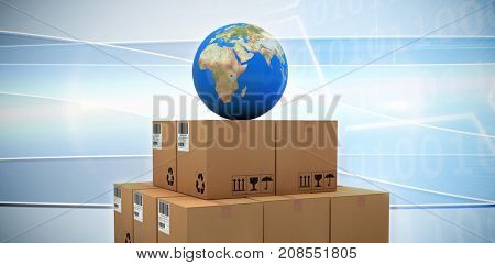 Blue globe on brown cardboard boxes against digital image of hexagon shape with binary numbers on screen