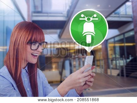 Digital composite of Woman holding phone with motorbike icon