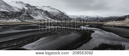 Beautiful panoramic winter landscape view of Iceland, snow capped on the mountains.