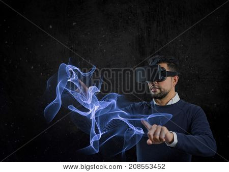 Digital composite of man using vr headset pointing