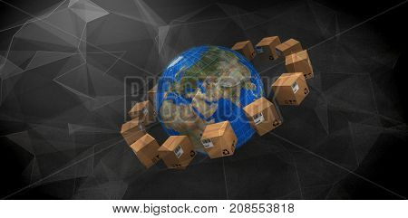 Planet earth amidst brown boxes against abstract glowing black background