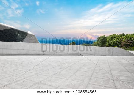 empty marble floor and cityscape   in cloud sky