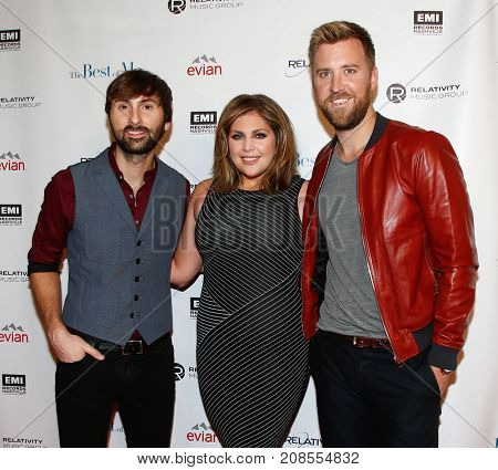 (L-R) Dave Haywood, Hillary Scott and Charles Kelley of Lady Antebellum attend