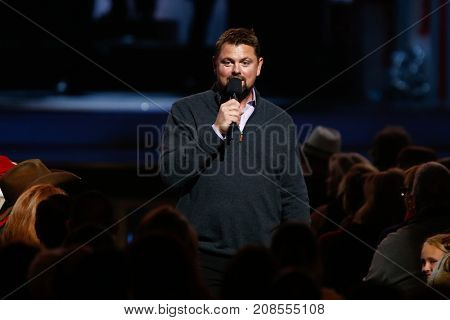 NASHVILLE, TN-NOV 7: Radio host Storme Warren entertains the audience at the 2014 CMA Country Christmas at the Bridgestone Arena on November 7, 2014 in Nashville, Tennessee.