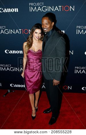 NEW YORK- OCT 24: Actress Eva Longoria (L) and Jamie Foxx attend the global premiere of Canon's