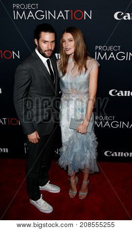 NEW YORK- OCT 24: Phil Winser (L) and Dree Hemingway attend the global premiere of Canon's