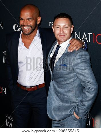 NEW YORK- OCT 24: Actors Amaury Nolasco and Lane Garrison (R) attend the premiere of Canon's 'Project Imaginat10n' Film Festival at Alice Tully Hall on October 24, 2013 in New York City.