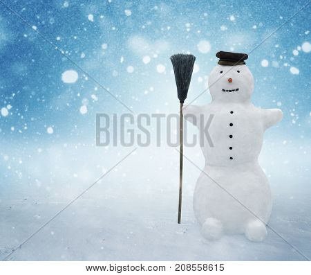 Snowman standing in winter christmas landscape. Snow background