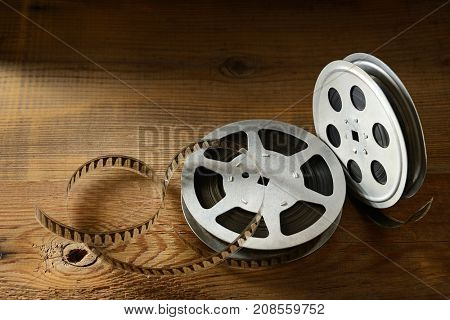 Old film strip on wooden background. Top view. Copy space for text