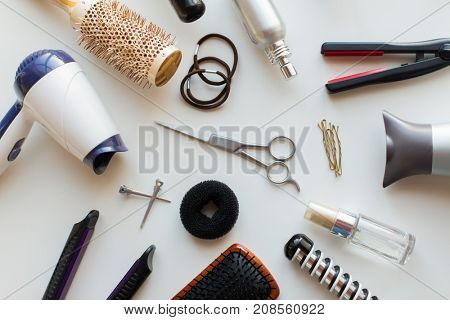 hair tools and hairdressing concept - scissors, hairdryers, irons, hot styling sprays and brushes on white background