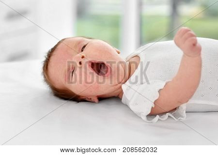 Adorable baby with skin allergy indoors
