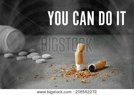 Broken cigarette and pills on table. Concept of smoking cessation