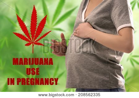 Pregnant woman smoking weed on blurred background
