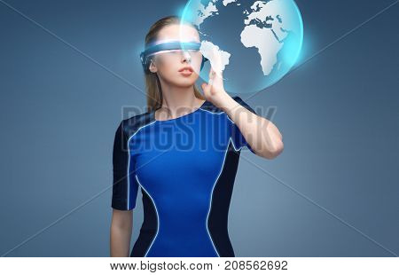augmented reality, science, technology and people concept - beautiful woman in futuristic 3d glasses with virtual earth projection over blue background