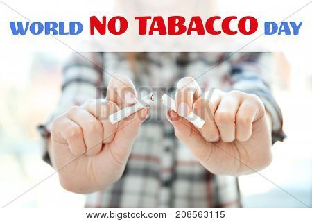 Text WORLD NO TOBACCO DAY and woman breaking cigarette on background