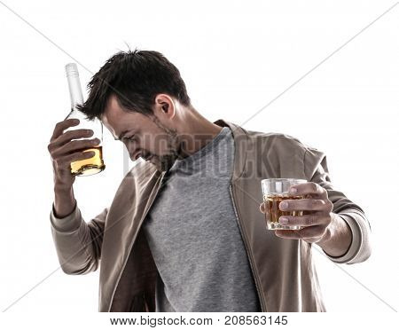 Drunk man with glass and bottle of alcohol drink on white background
