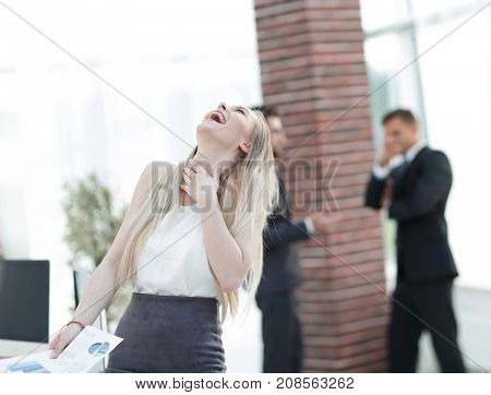 happy business woman with financial graphs