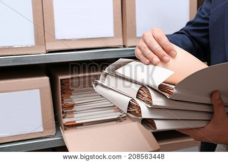 Man with documents in archive poster