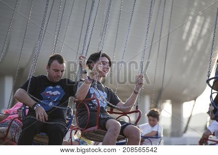 Cluj-Napoca, Romania - August 4, 2017:  People having fun on the carousel at Untold festival, one of the biggest music festivals in Eastern Europe