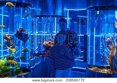 Photo of woman with son in the oceanarium