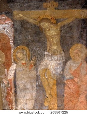 LUCCA, ITALY - JUNE 03: Crucifixion, Virgin Mary nd Saint John under the Cross, fresco painting in Basilica of Saint Frediano, Lucca, Tuscany, Italy on June 03, 2017.