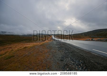 Long road in Norway in the middle of nowhere.