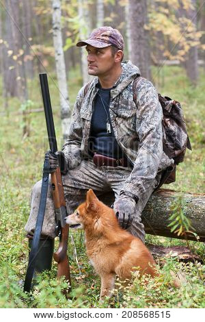 hunter with dogs finnish spitz during the rest