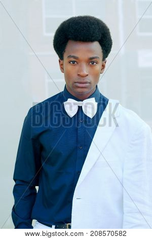 young man suit and tie bow dressed white background portrait