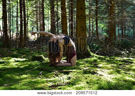 Women is posing in the forest, half naked in a sexy pose,