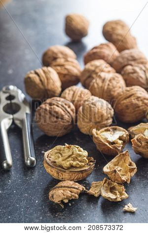 Tasty dried walnuts with nutcracker.
