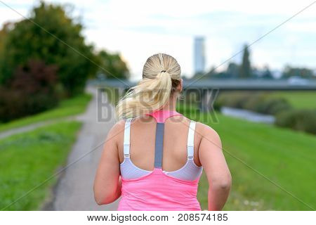 Blonde Woman Running Along River