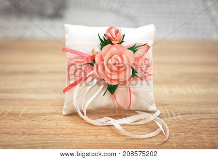 Wedding accessories. Elegant pillow or cushion for rings. Wedding ceremony.