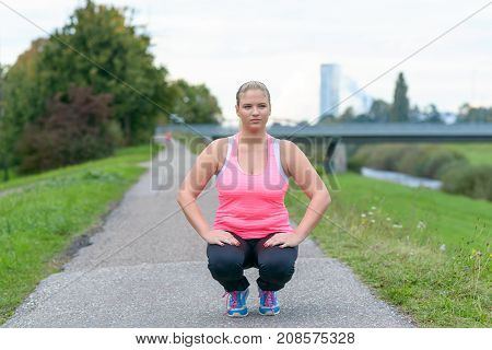 Young Blonde Woman Exercising In Park