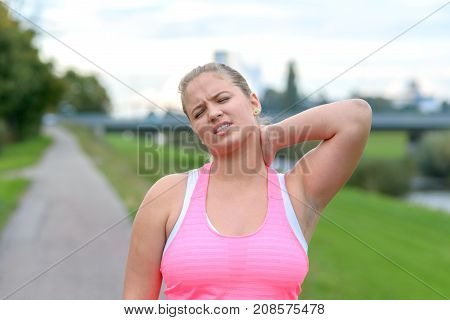 Young Blonde Woman Holding Her Painful Neck