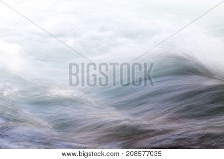 background of turbulent water in the mountain river .