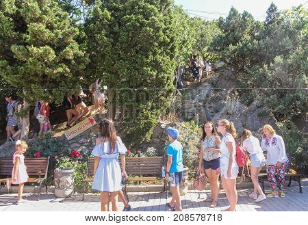 Yalta, Crimea - 11 July, Tourists on vacation, 11 July, 2017. Small Castle Lastochkino Nest and its surroundings.