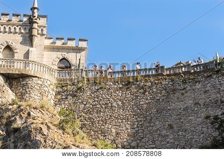 Yalta, Crimea - 11 July, People are at the railing, 11 July, 2017. Small Castle Lastochkino Nest and its surroundings.